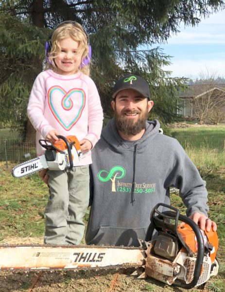 Infinity Tree Services, enjoying a bit of father daughter time, posing on the job #DoWork #BigSawLittleSaw Enjoy your work and your family, this is the apex of joy.
