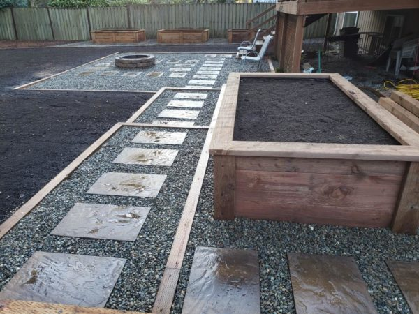 Fire Pit by Infinity Tree LLC in Des Moines WA. Built from bricks and surrounded by rocks. What a nice area for family fire gatherings!