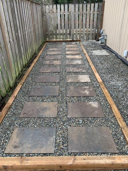 Framed gravel and stone slab pathway